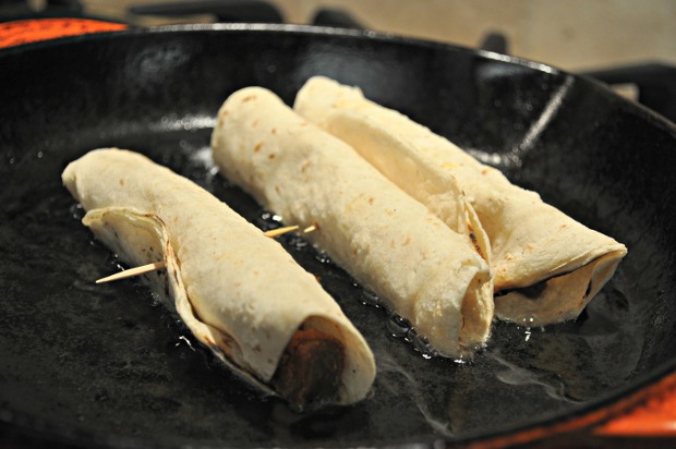 frying beef tongue flautas